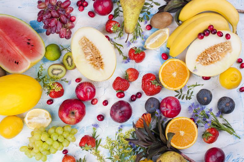 Different fruits on a light background. Vitamins and diet. Summer berries and fruits. Healthy food. Background. Vegetarian . stock photography