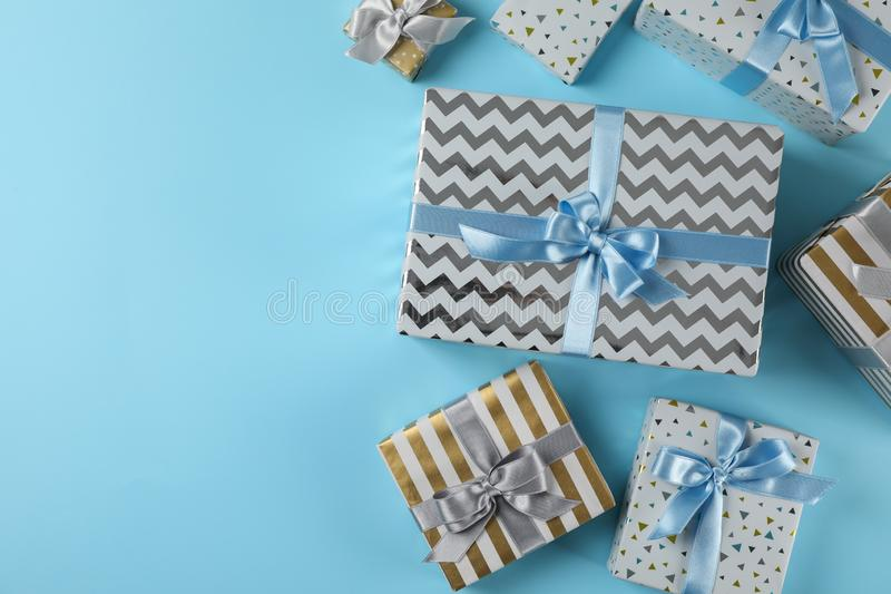 Different gift boxes on blue background. Copy space stock images