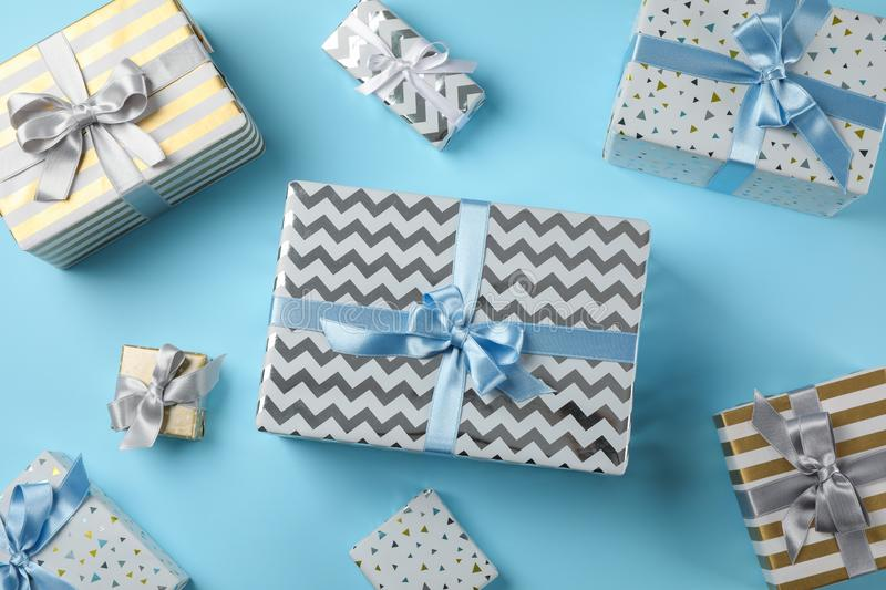 Different gift boxes on blue background. Top view royalty free stock photography