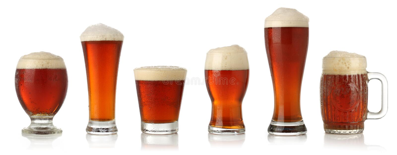 Different glasses of cold beer. Isolated on white stock photos