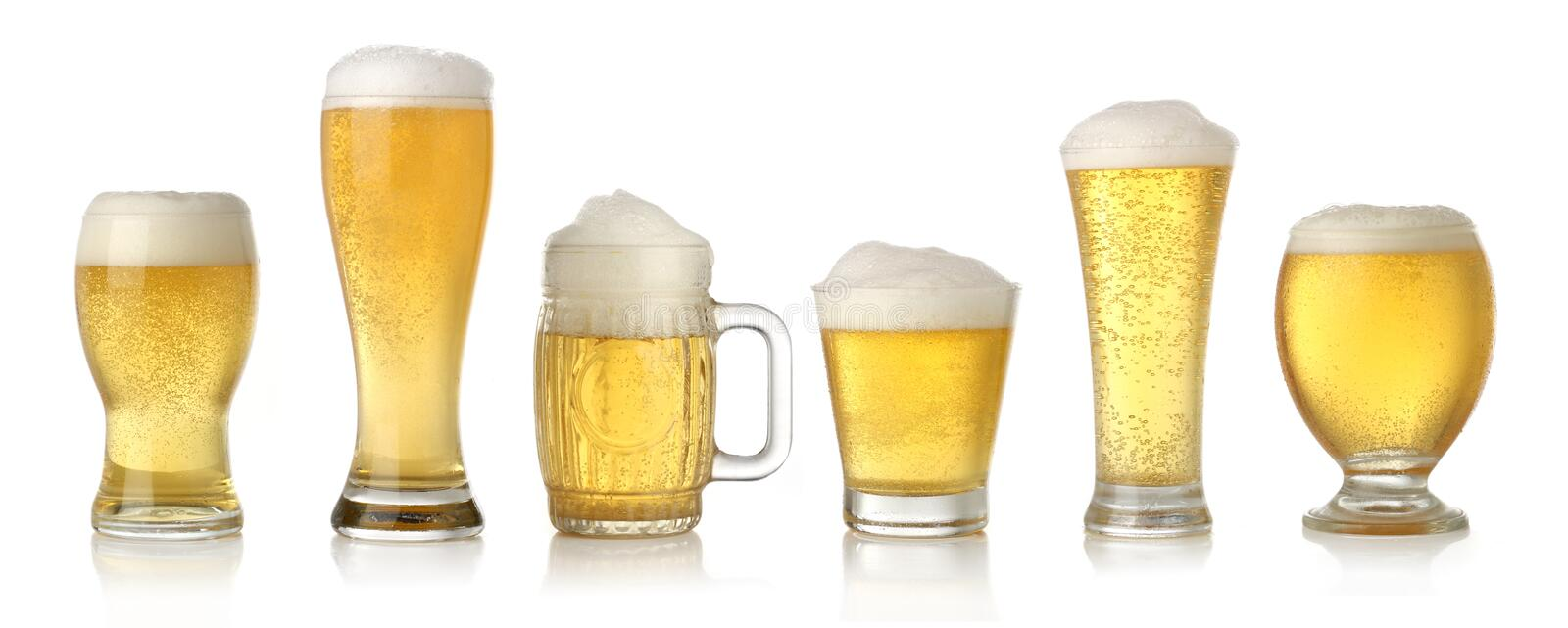 Different glasses of cold lager beer. Isolated on white royalty free stock photography