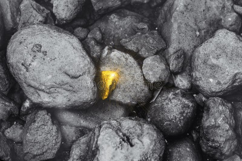Different golden stone found around dirty rock business employee performance outstanding. Person concept stock photography