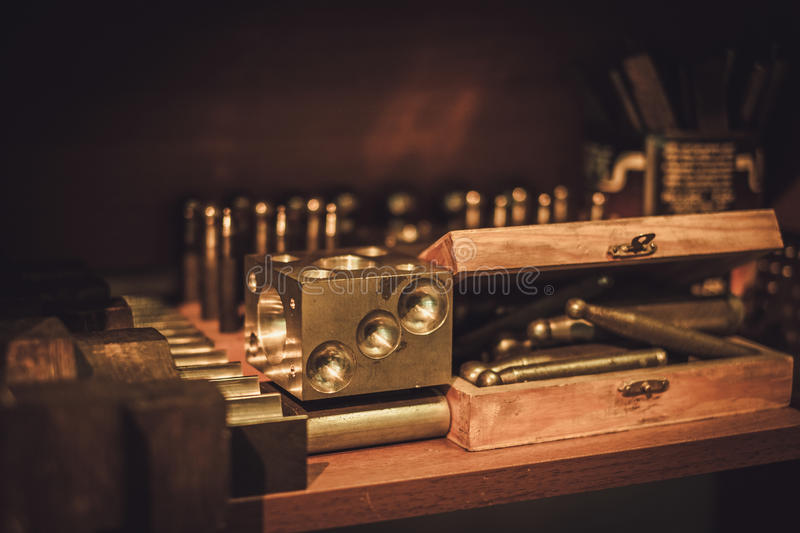 Different goldsmiths tools on the jewellery workplace royalty free stock images