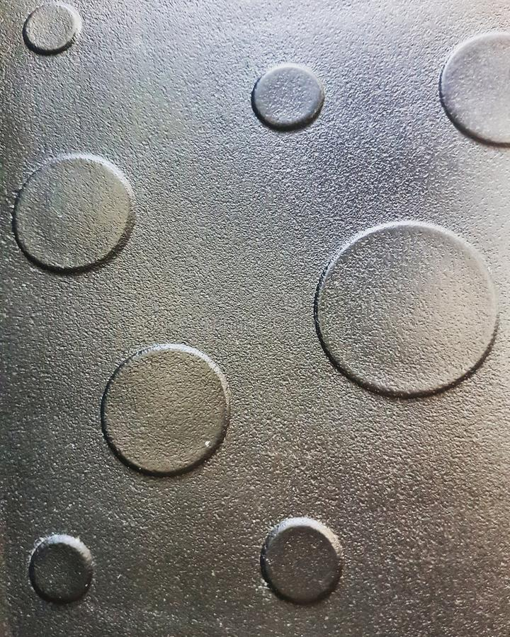 Different gray circles. Background. Texture. Different gray circles. Background and texture. Gray surface.nLittle and big circles royalty free stock photo