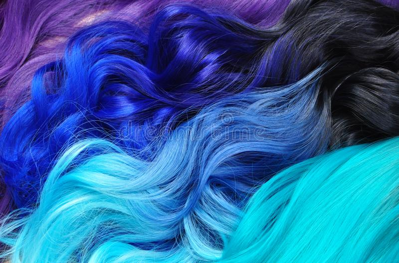 Different hair styles; ombre dyed hair: black to turquoise, blue. To turquoise, black to blue, violet or purple; bright dyed hair, vivid colors, hair salon royalty free stock photography