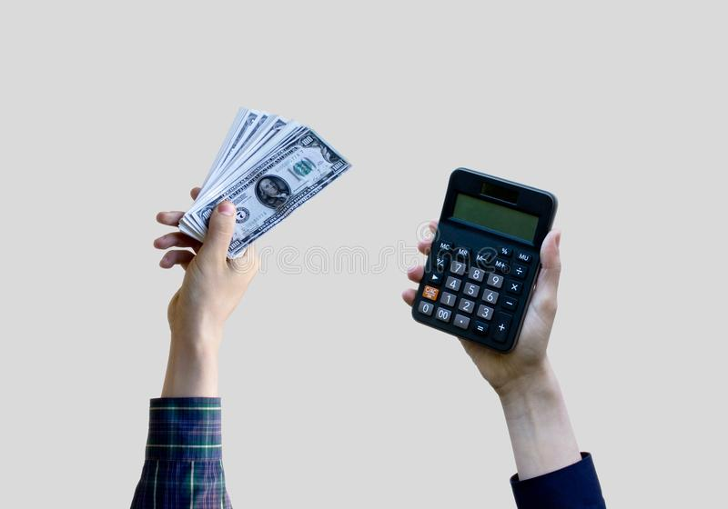 Different hands holding money with calculator. stock photo