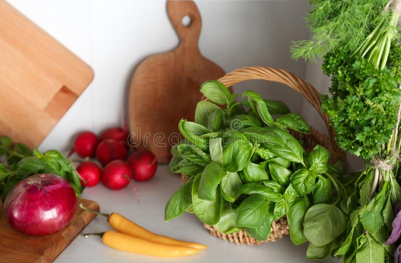 Different herbs and vegetables in kitchen royalty free stock photography