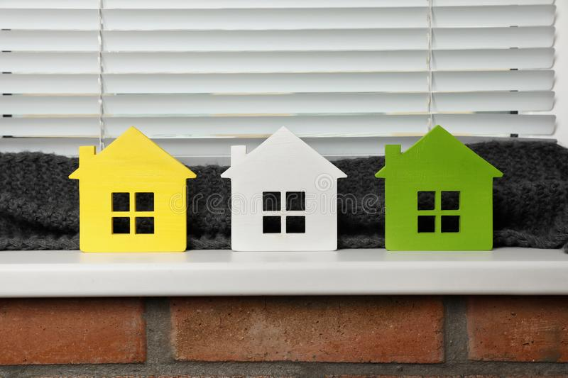 Different house models on  indoors. Heating efficiency. Different house models on windowsill indoors. Heating efficiency royalty free stock photo