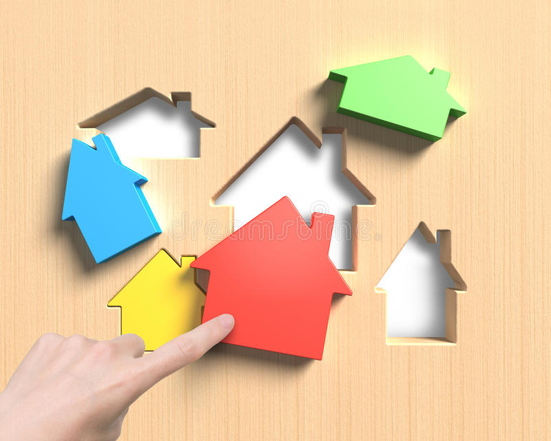 Different houses suit house shape holes board with hand assembli stock photos