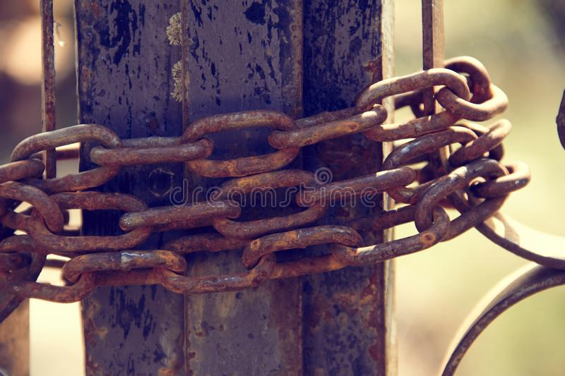 Different images of closed field fence with rusty chain stock images