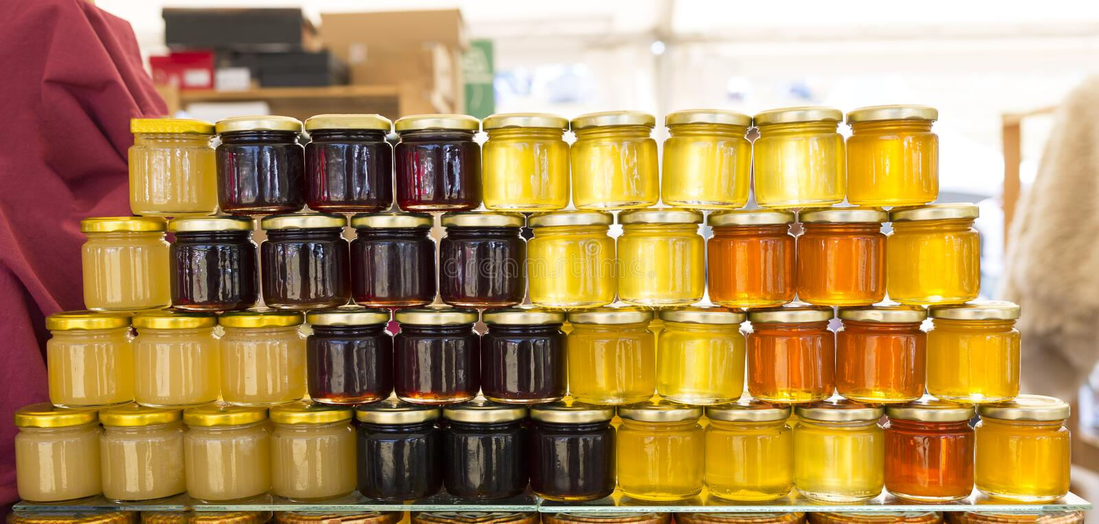 Different jars of honey royalty free stock images