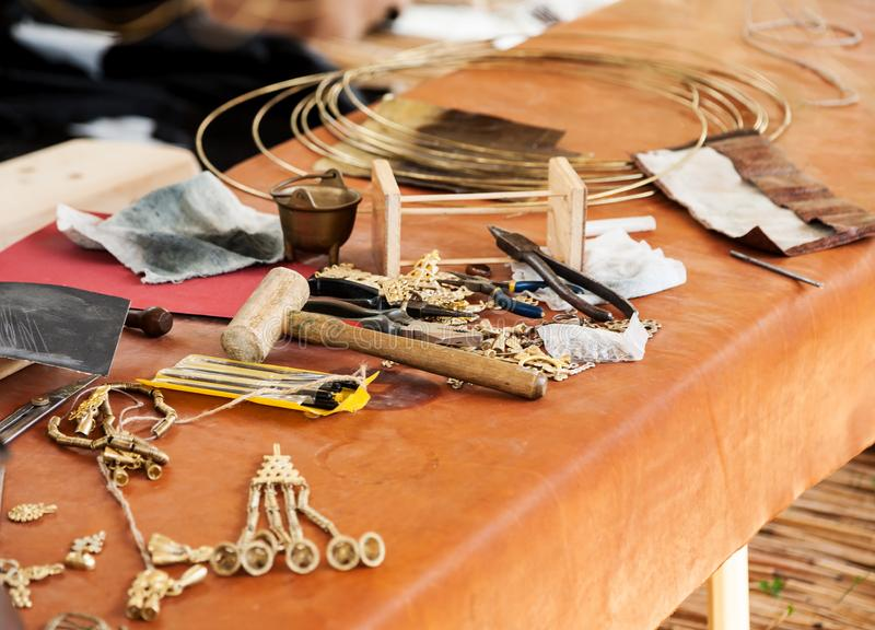 Different jeweler tools on a table, selective focus. Different jeweler tools on a table, selective , jewelry, jewellery, accessory, closeup, craft, equipment royalty free stock photography