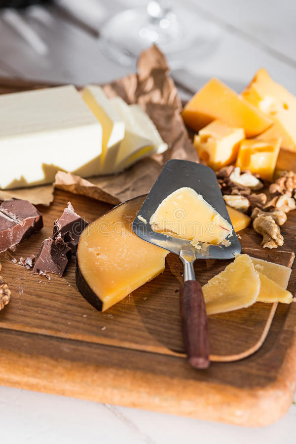 The different kind of cheese and walnuts on wooden background royalty free stock images