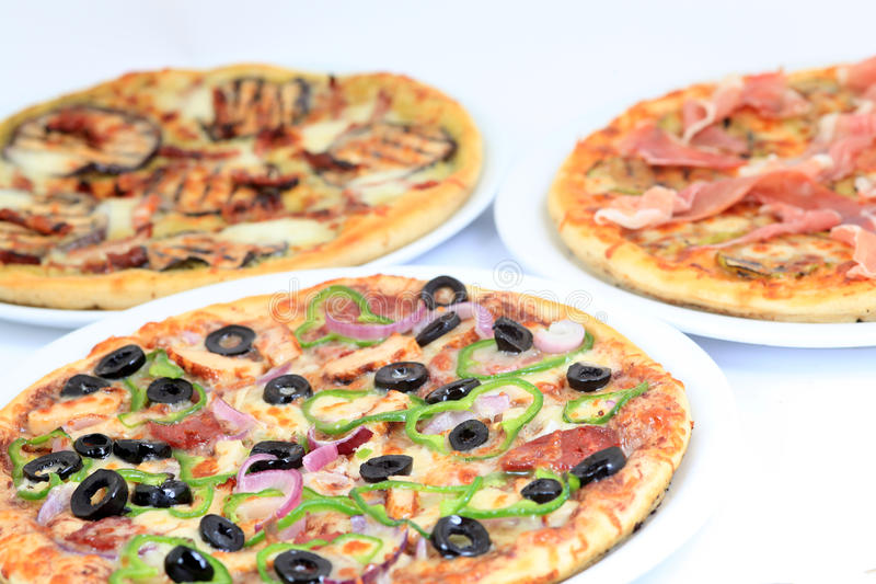 Different kind of pizzas. Three different kind of pizzas stock photography