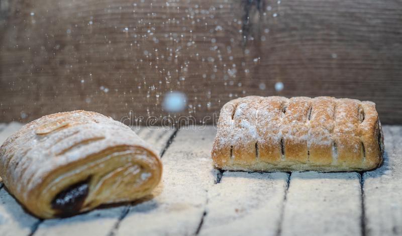 Different kinds of bread rolls on black board from above royalty free stock images