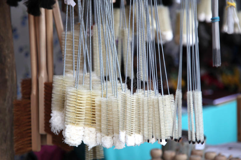 Different kinds of brushes for cleaning and household. Different kinds of brushes on display in a household goods market royalty free stock photo