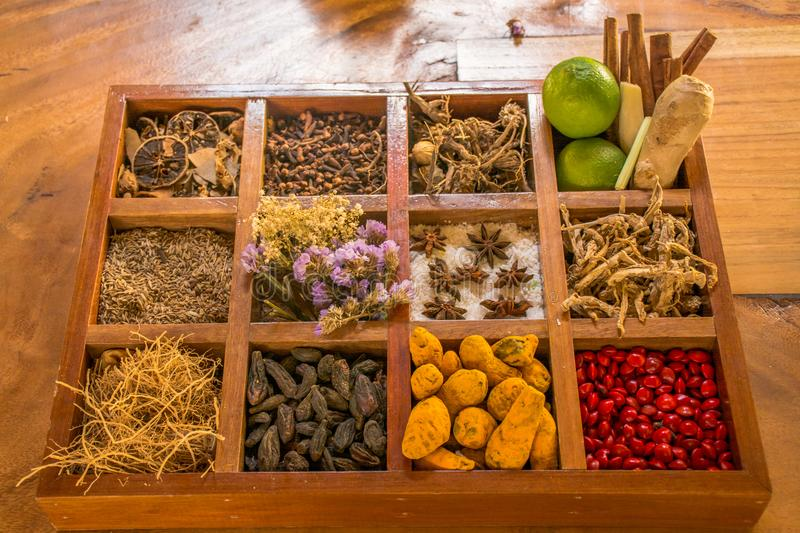 Variety of condiments and spices in the wooden box on the table stock images
