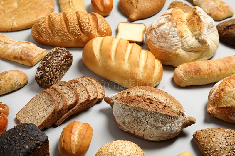 Different kinds of fresh bread on light. Background stock image