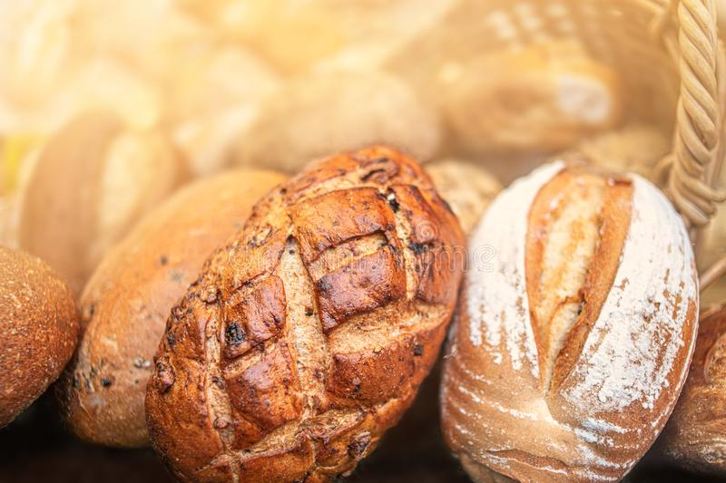 Different kinds of Freshly Baked  Bread, may use as background, top view.  Rustic loaves of bread close up stock photography