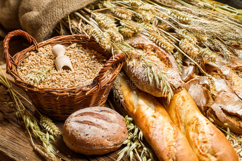 Different kinds of grain and freshly baked bakery products stock photo