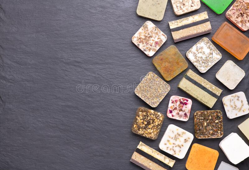 Different kinds of homemade soap with aromatic, healthy herbs stock image