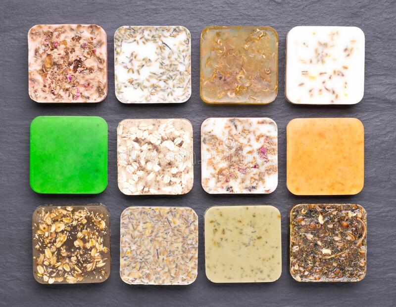 Different kinds of homemade soap with aromatic, healthy herbs stock photos