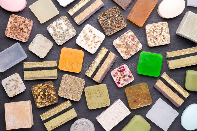 Different kinds of homemade soap with aromatic, healthy herbs stock photo