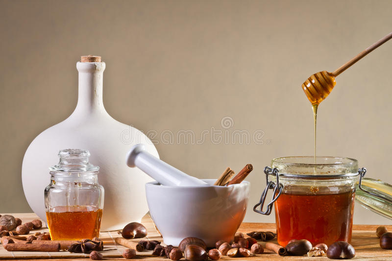 Different kinds of nuts and honey stock photography