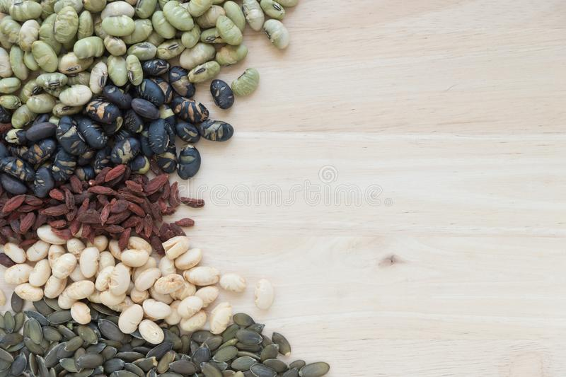 Different kinds of nuts on wooden background with copy space. stock photography