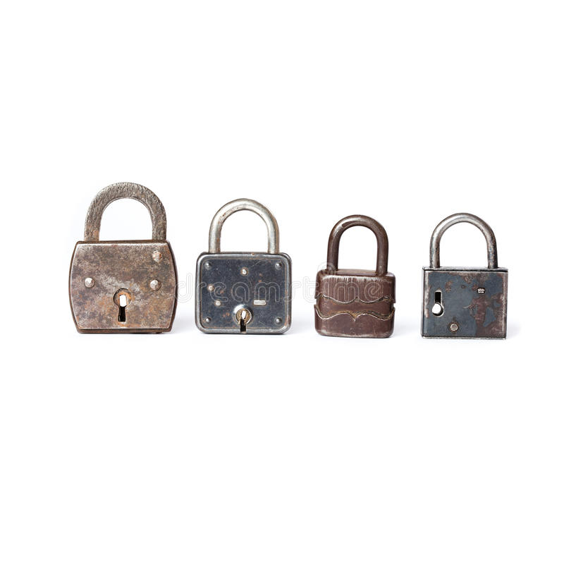 Different kinds padlocks with key hole. White royalty free stock photo