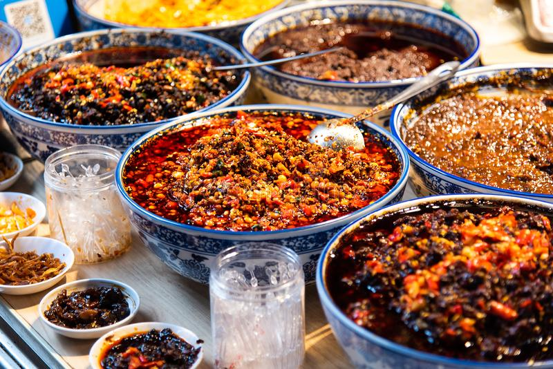 Different kinds of spicy sauces in Sichuan, China. Different kinds of spicy sauces in Sichuan province of China, food, szechuan, store, street, market, pepper stock photography