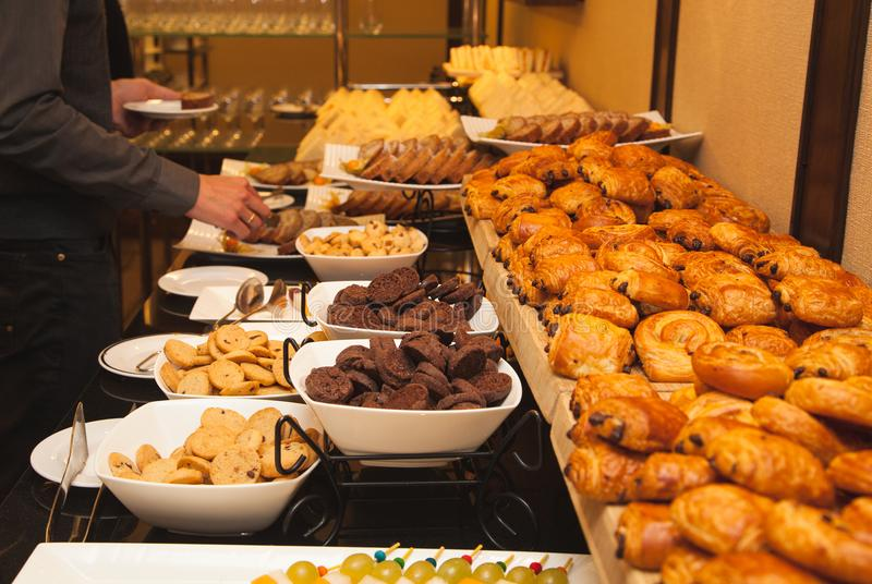 Different kinds of sweets and baked goods at the banquet,. Self-service stock photography