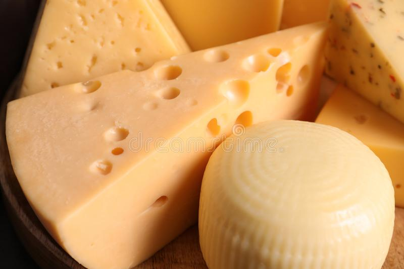 Different kinds of tasty cheese on wooden plate. Closeup royalty free stock photos