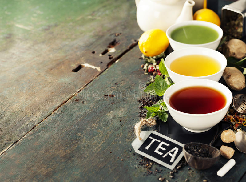 Different kinds of tea in ceramic bowls stock photo