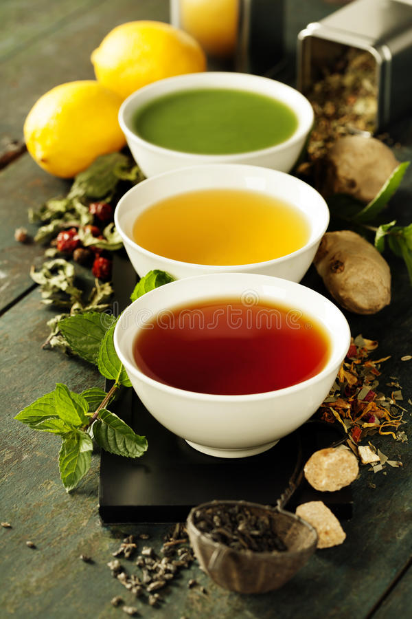 Different kinds of tea in ceramic bowls stock photos