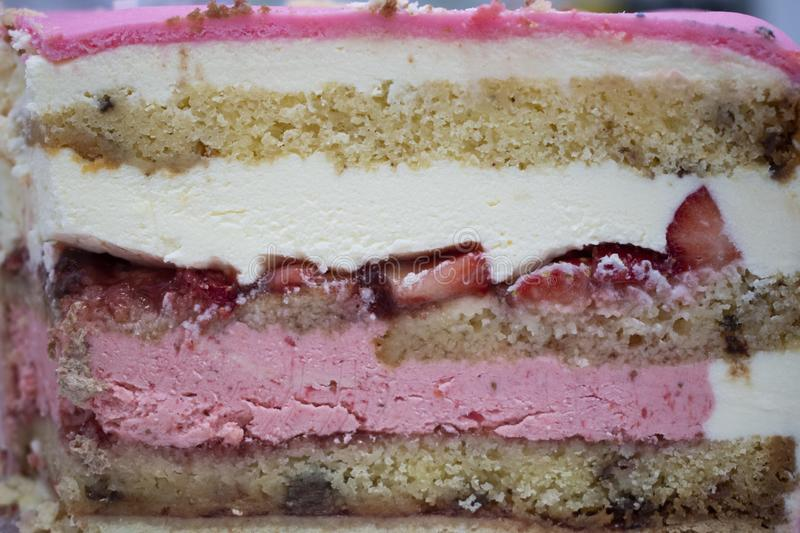 Different layers in  strawberry cake stock photography