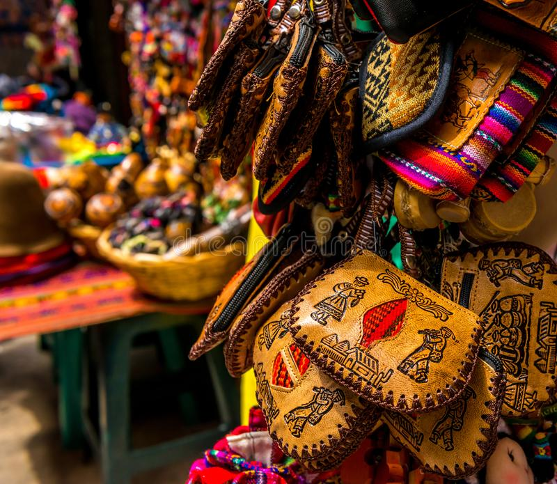 Different leather and fabric handbags on the souvenir store in Bolivia. Different leather and fabric handbags with different patterns on the souvenir store in stock images