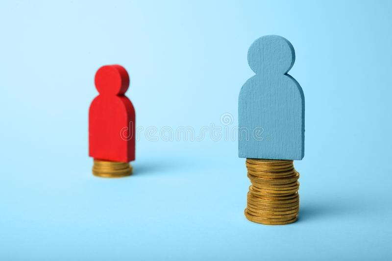 Different level pay income of people. Financial gap concept.  royalty free stock image