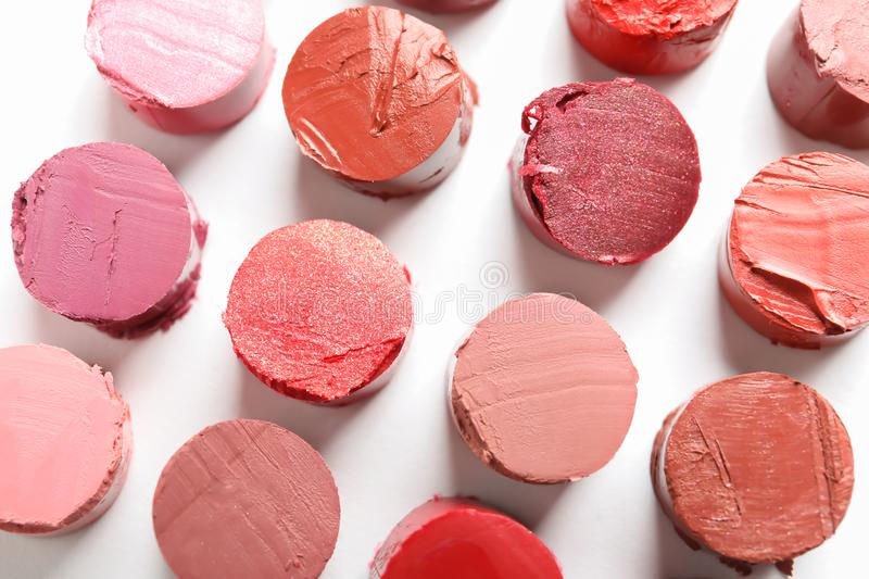 Different lipstick swatches on white background. Top view royalty free stock photography