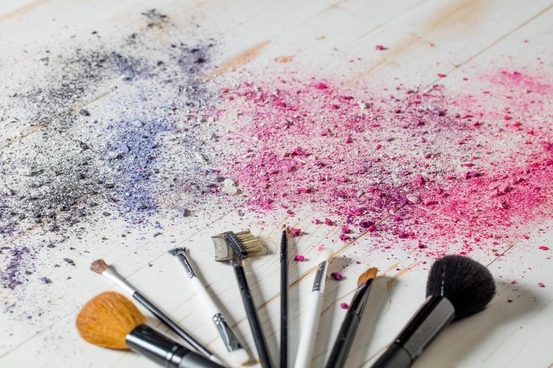 Makeup brushes and eyeshadow colors top view beauty still life royalty free stock images
