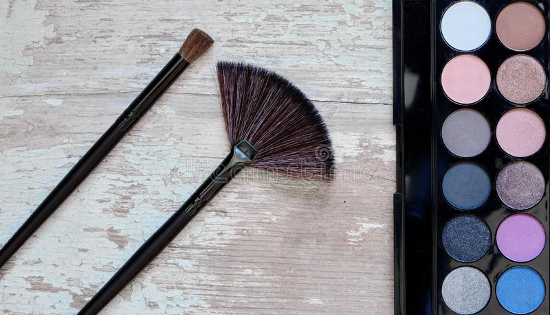 Different makeup cosmetics on rustic white wooden table. royalty free stock photo