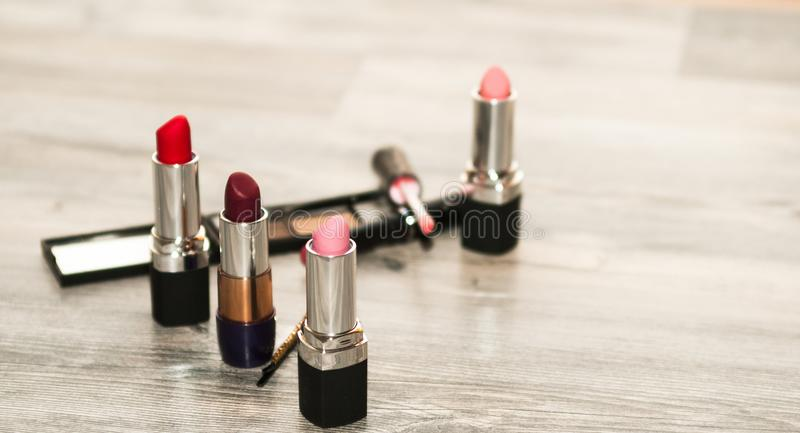 Different makeup cosmetics on white wooden table. Cosmetics image royalty free stock photography