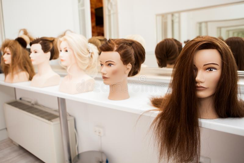 Different mannequin with different hairstyles stock photos