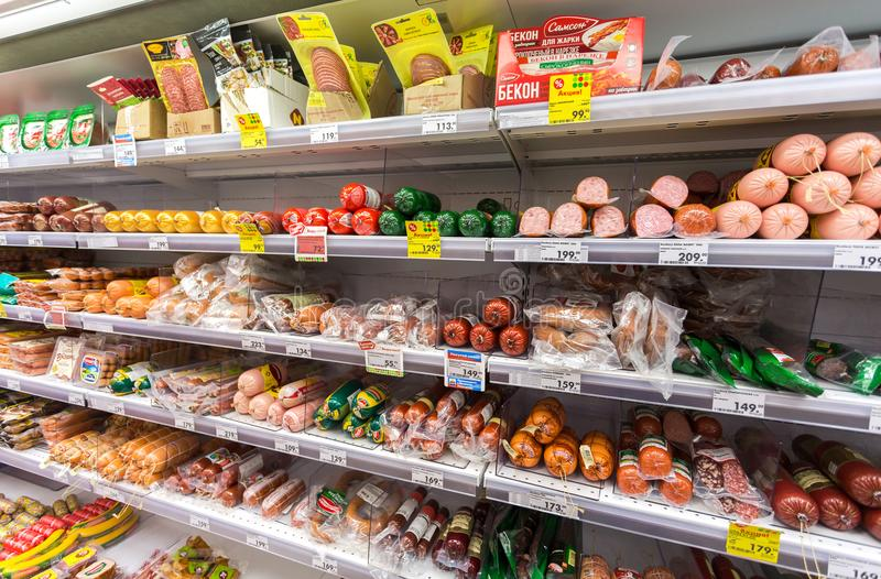 Different meat and sausage ready for sale in the supermarket Pyaterochka stock photo