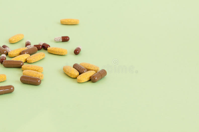 Different medicaments. Different pills, tablets, drugs and medicaments on green background royalty free stock images