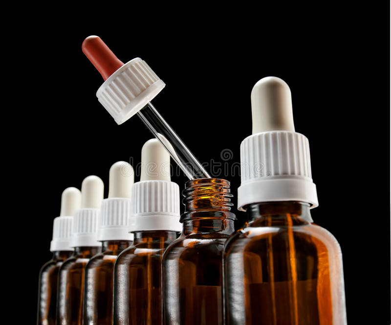 Different medication. Different color of one of droppers in a row can suggest an alternative choice in a medical therapy royalty free stock photo