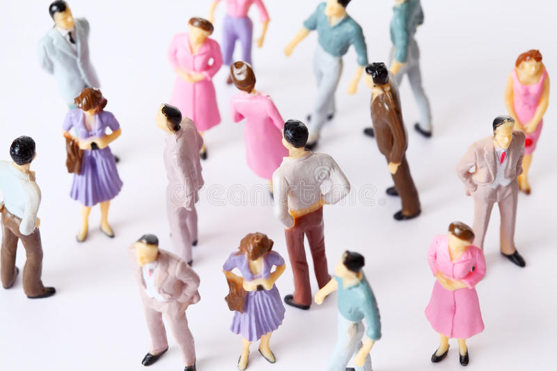 different miniature people poses stand toy 免版税库存图片