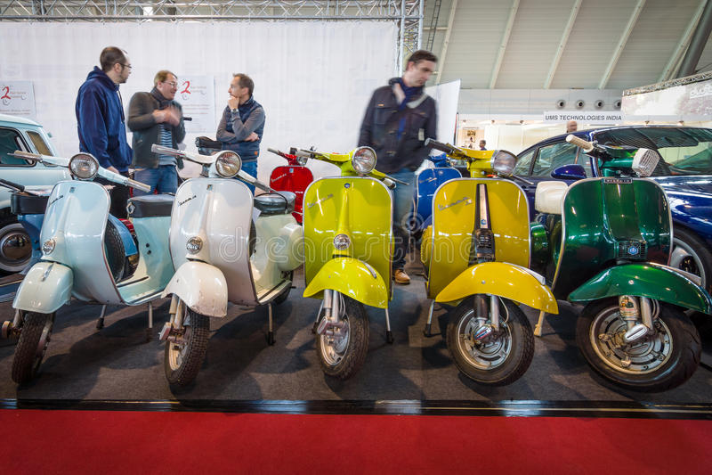 Different models of Vespa scooter standing in a row. STUTTGART, GERMANY - MARCH 18, 2016: Different models of Vespa scooter standing in a row. Europe's greatest royalty free stock photography