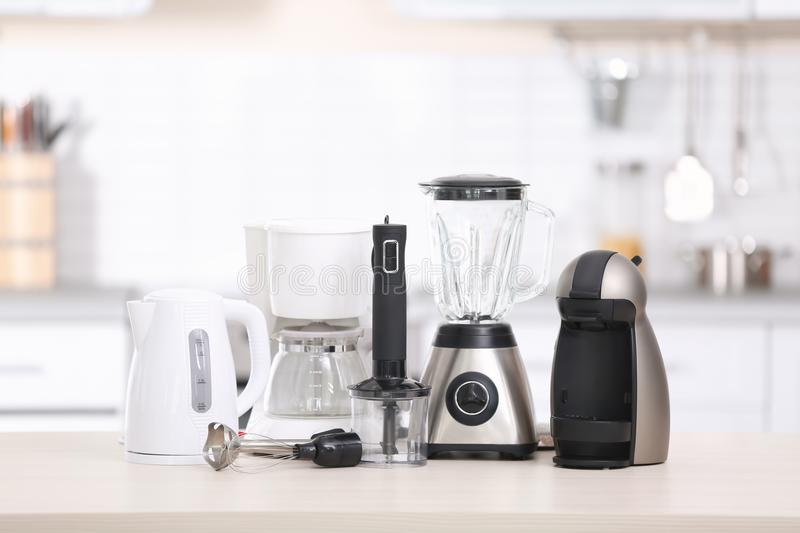 Different modern kitchen appliances. On table indoors. Interior element stock photography