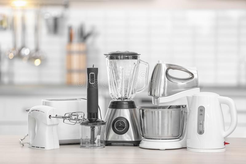 Different modern kitchen appliances on table indoors. Interior element royalty free stock photo